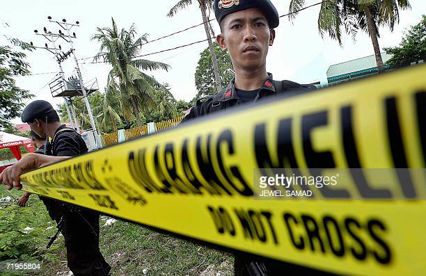 Police cordon off an area in front of the central jail where three Christians on death row for inciting violence against Muslims six years ago are...