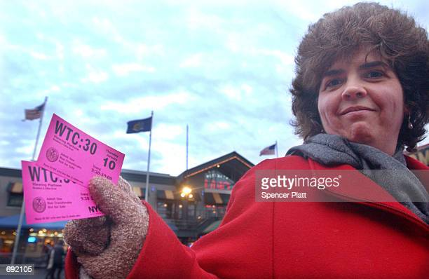 Pam a tourist from New Jersey holds tickets to a ground zero viewing platform January 9 2002 at South Street Seaport in New York City In an effort to...