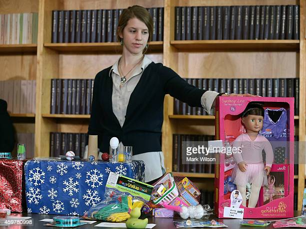 Pam Clough of the US Public Interest Research Group stands with hazardous toys during a news conference releasing the yearly report of most dangerous...