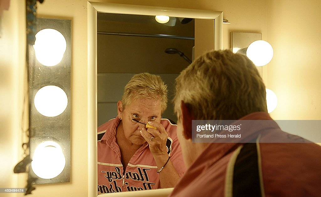 Pam Hillock of Hollis applies makeup at her home Monday, June 16, 2014. Hillock would have had a difficult time applying makeup before getting deep brain stimulation due to neck tremors.