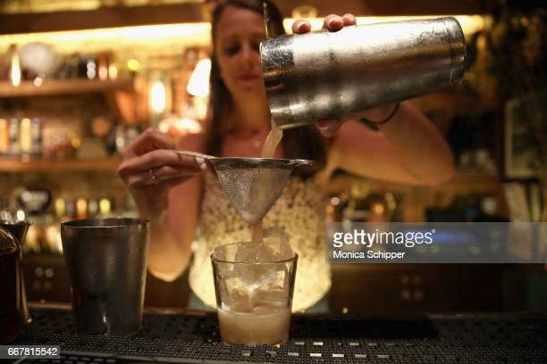 Pam Wiznitzer bartends at the Dead Rabbit to launch the new 1893 flavors Black Currant Cola and Citrus Cola at The Dead Rabbit on April 12 2017 in...