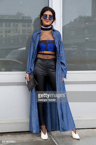 Pamela Allier is seen at Spring Studios outside the Lacoste show wearing waist high fishnet stockings black leather pants sheer top with blue strip...