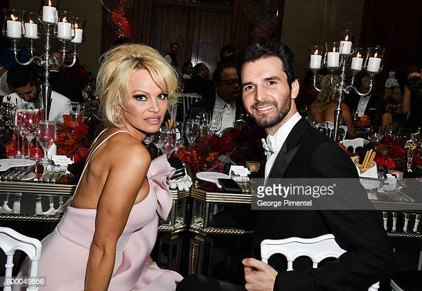 Pamela Anderson and AMBI Pictures cofounder Andrea Iervolino attend the 2016 Toronto International Film Festival 'AMBI Gala' at Ritz Carlton on...