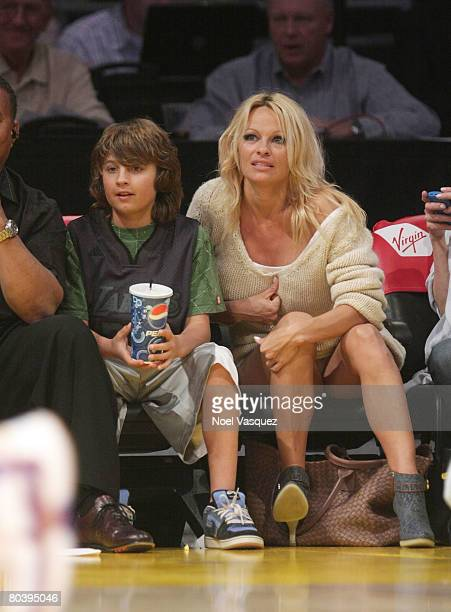 Pamela Anderson and Brandon Thomas Lee attends the Los Angeles Lakers game against the Charlotte Bobcats at the Staples Center on March 26 2008 in...