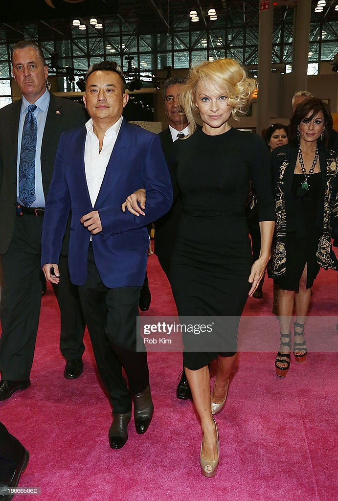 <a gi-track='captionPersonalityLinkClicked' href=/galleries/search?phrase=Pamela+Anderson&family=editorial&specificpeople=171759 ng-click='$event.stopPropagation()'>Pamela Anderson</a> and Creative Director for Obliphica Professional John Blaine attend the International Beauty Show at Jacob Javits Center on April 15, 2013 in New York City.