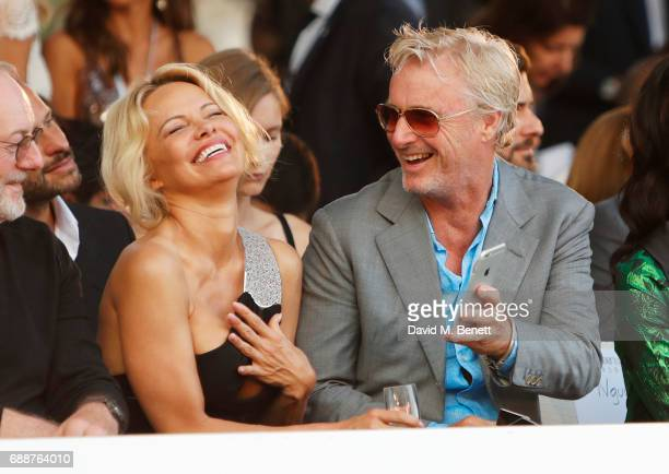 Pamela Anderson and Eddie Irvine attend the Amber Lounge Fashion Monaco 2017 at Le Meridien Beach Plaza Hotel on May 26 2017 in Monaco Monaco