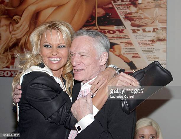 Pamela Anderson and Hugh Hefner during Hugh Hefner and International Images Launch the Playboy Legacy Collection at Republic in Los Angeles...