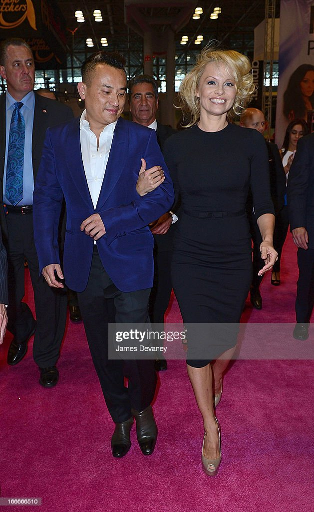 <a gi-track='captionPersonalityLinkClicked' href=/galleries/search?phrase=Pamela+Anderson&family=editorial&specificpeople=171759 ng-click='$event.stopPropagation()'>Pamela Anderson</a> and John Blaine (L) attend the International Beauty Show at the Javits Center on April 15, 2013 in New York City.