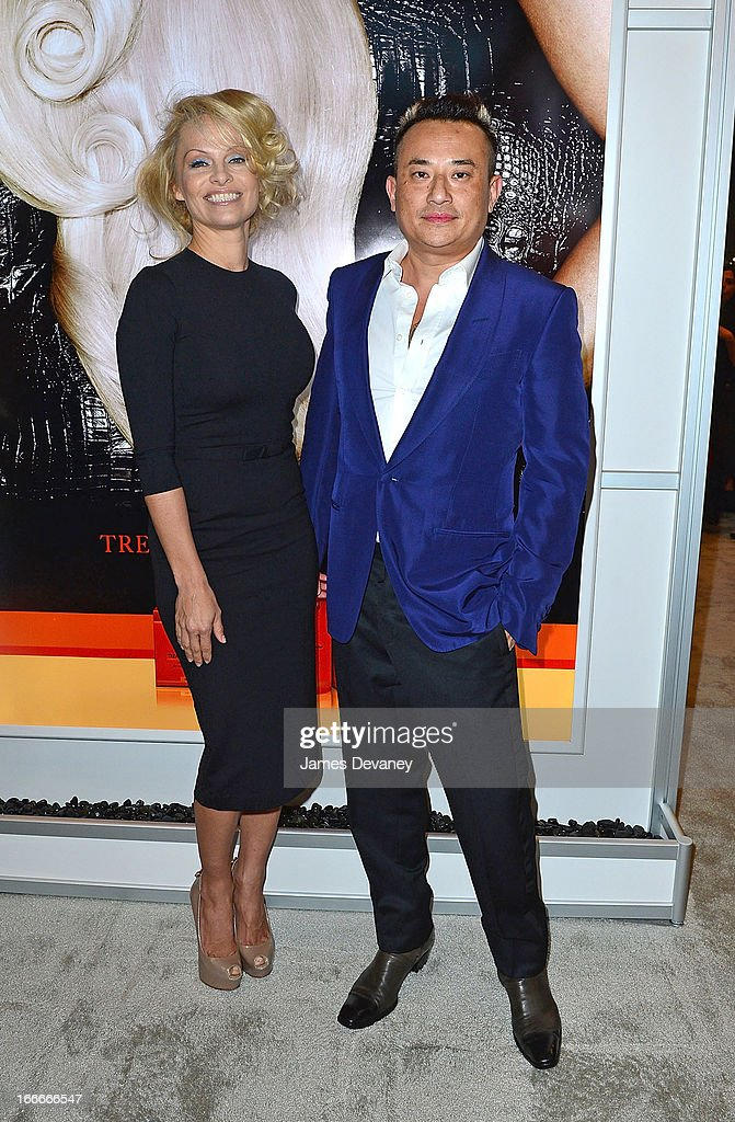 Pamela Anderson and John Blaine attend the International Beauty Show at the Javits Center on April 15, 2013 in New York City.