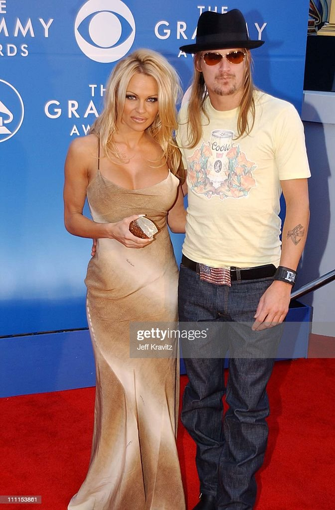 <a gi-track='captionPersonalityLinkClicked' href=/galleries/search?phrase=Pamela+Anderson&family=editorial&specificpeople=171759 ng-click='$event.stopPropagation()'>Pamela Anderson</a> and <a gi-track='captionPersonalityLinkClicked' href=/galleries/search?phrase=Kid+Rock&family=editorial&specificpeople=171123 ng-click='$event.stopPropagation()'>Kid Rock</a> during The 44th Annual Grammy Awards at Staples Center in Los Angeles, California, United States.