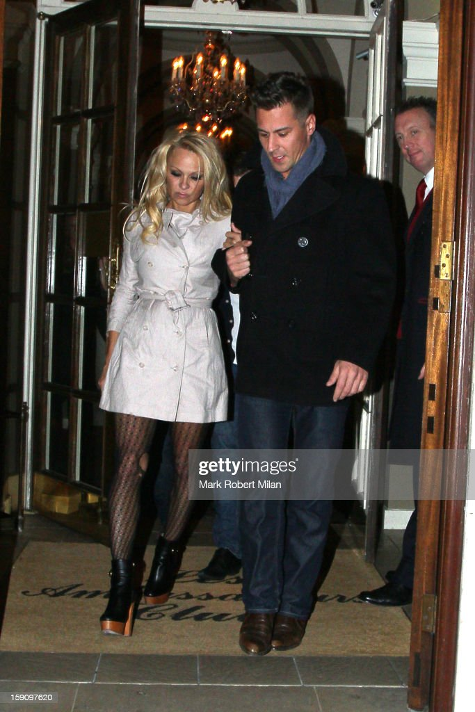 <a gi-track='captionPersonalityLinkClicked' href=/galleries/search?phrase=Pamela+Anderson&family=editorial&specificpeople=171759 ng-click='$event.stopPropagation()'>Pamela Anderson</a> and Matt Evers at Les Ambassadeurs club on January 7, 2013 in London, England.