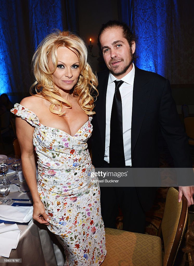 Pamela Anderson and musician Citizen Cope attend the 2nd Annual Sean Penn and Friends Help Haiti Home Gala benefiting J/P HRO presented by Giorgio Armani at Montage Hotel on January 12, 2013 in Los Angeles, California.