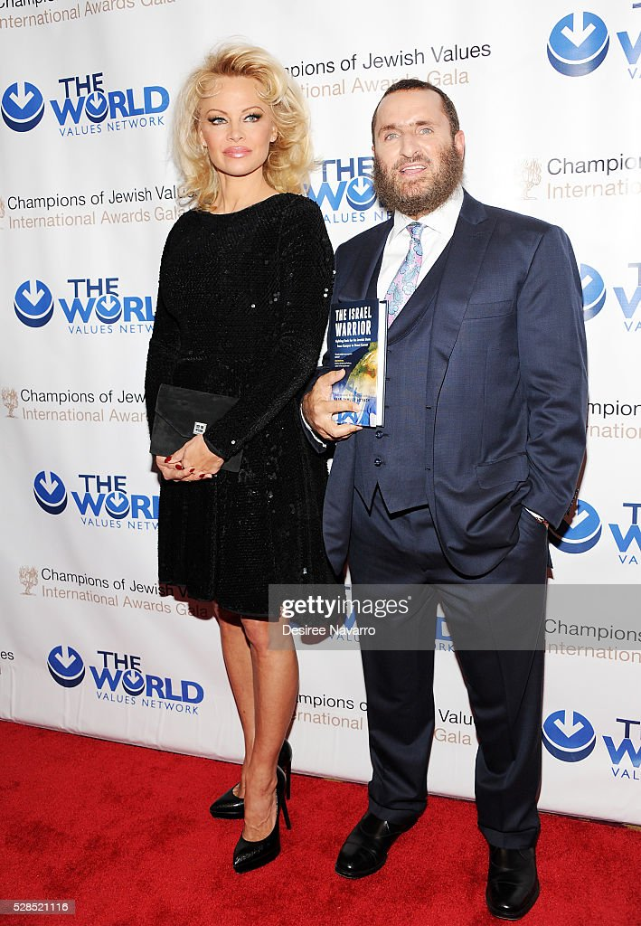 Pamela Anderson and Rabbi Shmuley Boteach attend the 4th Annual Champions Of Jewish Values International Awards Gala at Marriott Marquis Broadway Ballroom on May 5, 2016 in New York City.