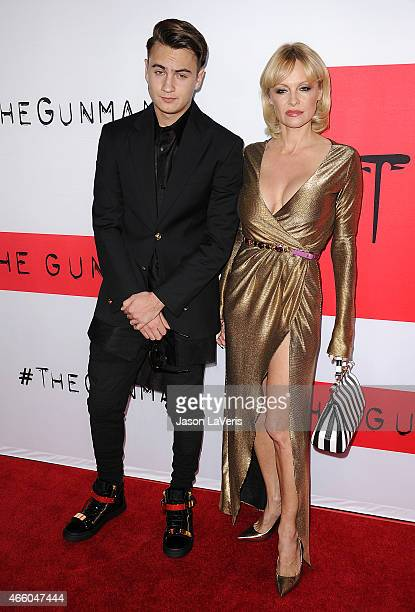 Pamela Anderson and son Brandon Thomas Lee attend the premiere of 'The Gunman' at Regal Cinemas LA Live on March 12 2015 in Los Angeles California