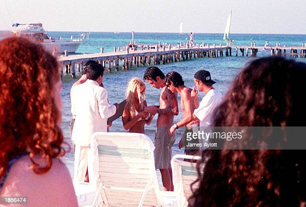 Pamela Anderson and Tommy Lee get married February 19 1995 on the beach in Cancun Mexico as fans watch nearby