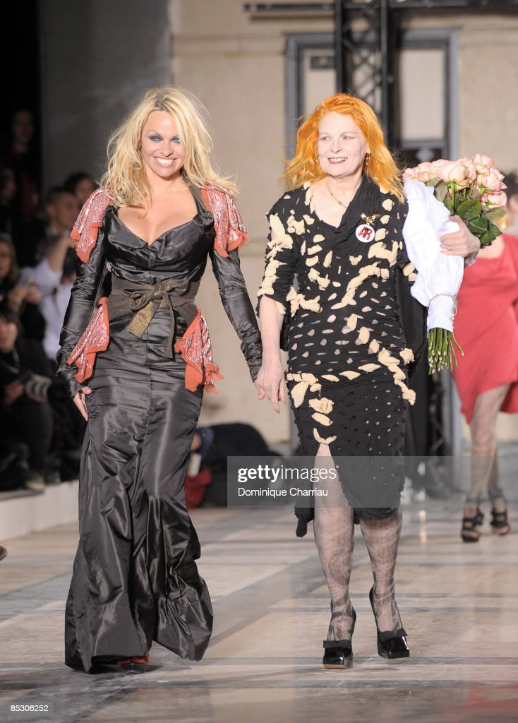 Pamela Anderson and Vivienne Westwood walk the runaway at the Vivienne Westwood ReadytoWear A/W 2009 fashion show during Paris Fashion Week at...