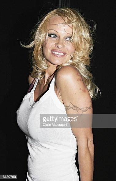 Pamela Anderson arrives at the Rodeo Drive Walk of Style Event Honoring Tom Ford on March 28 2004 in Beverly Hills California