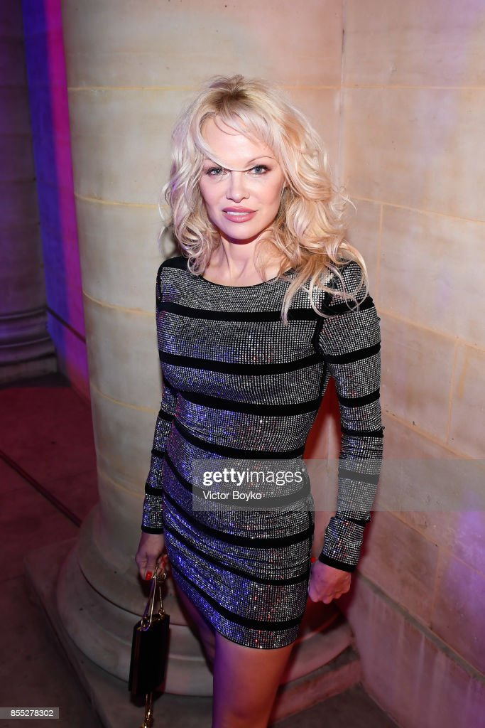 Pamela Anderson attends L'Oreal Paris X Balmain Party as part of the Paris Fashion Week Womenswear Spring/Summer 2018 on September 28, 2017 in Paris, France.