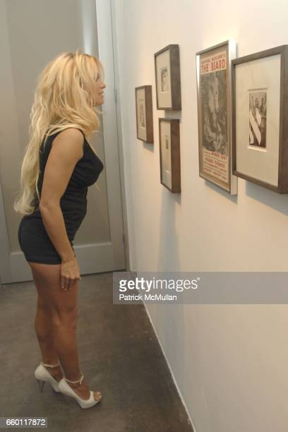 Pamela Anderson attends SHE Images of women by Wallace Berman and Richard Prince Opening at Michael Kohn Gallery on January 15 2009 in Beverley Hills...