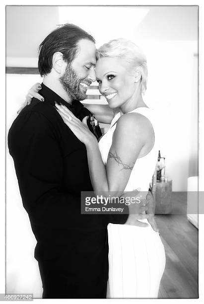 Pamela Anderson is photographed with Rick Salomon on their wedding day at her home in Malibu California on January 9 2014
