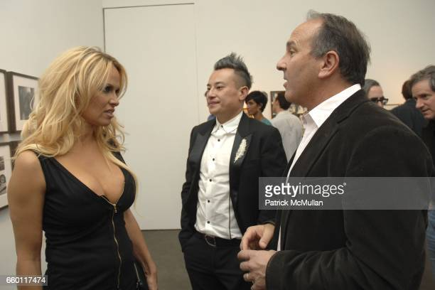 Pamela Anderson John Blaine and Michael Kohn attend SHE Images of women by Wallace Berman and Richard Prince Opening at Michael Kohn Gallery on...