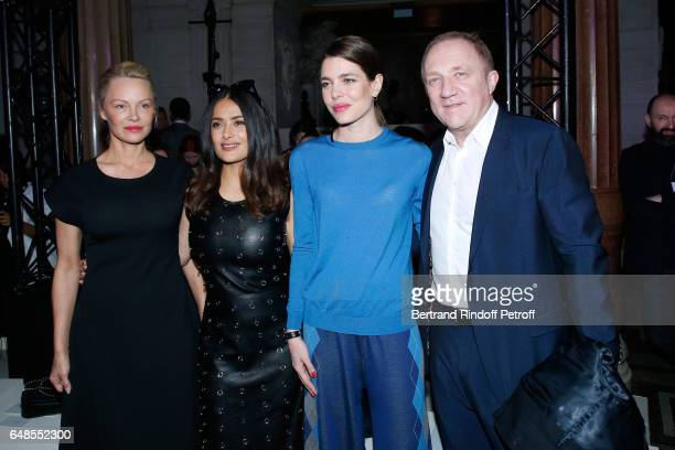 Pamela Anderson Salma Hayek Charlotte Casiraghi and CEO of Kering Group FrancoisHenri Pinault attend the Stella McCartney show as part of the Paris...
