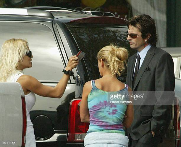Pamela Anderson talks with former husband and musician Tommy Lee drummer for Motley Crue at the Malibu Courthouse after a probation progress report...