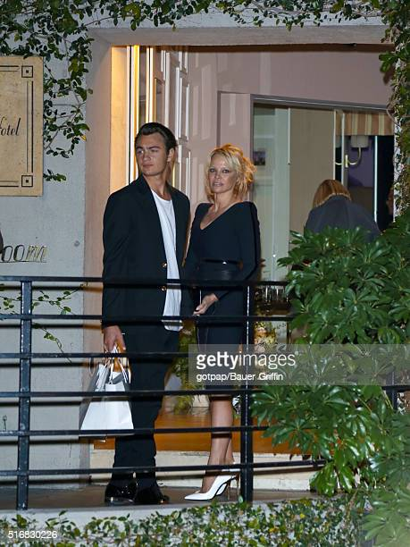 Pamela Anderson with her son Brandon Thomas Lee are seen leaving 'Fashion Los Angeles Awards' at Sunset Tower Hotel on March 20 2016 in Los Angeles...