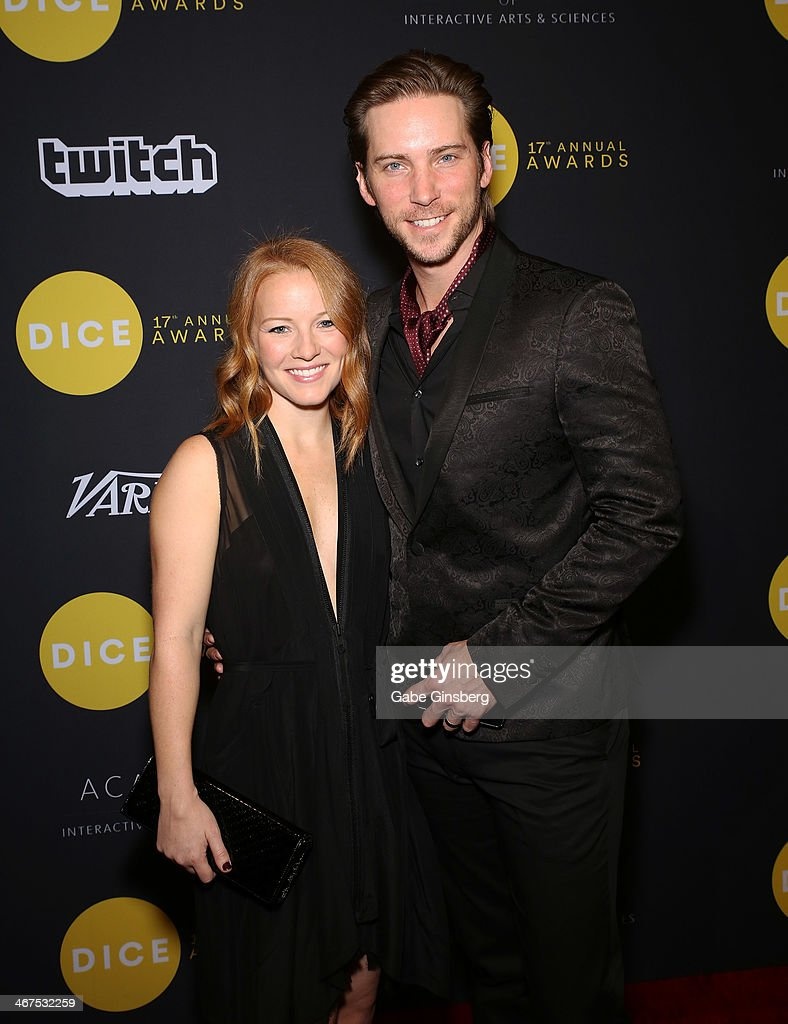 Pamela Baker (L) and her husband, actor Troy Baker arrive ...