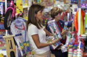 Pamela Carpenter and Enna De Latorre shop for gifts at Toy Town as the last days of Christmas shopping arrive December 21 2006 in Key Biscayne...