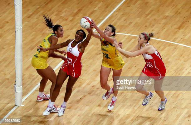 Pamela Cookey of England beats Rebecca Bulley of Australia to the ball during the International Netball Series between England and Australia at...