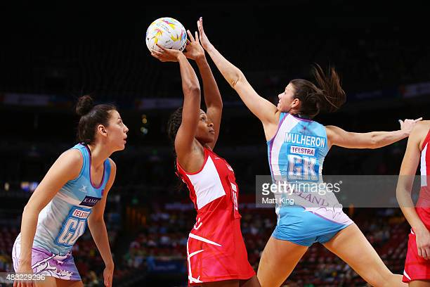 Pamela Cookey of England is challenged by Hayley Mulheron of Scotland during the 2015 Netball World Cup match between England and Scotland at...