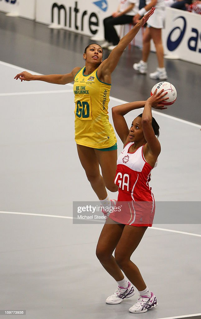 Pamela Cookey (R) of England shoots as Chanel Gomes (L) of Australia challenges during the England v Australia International Netball Series match at the University of Bath on January 20, 2013 in Bath, England.