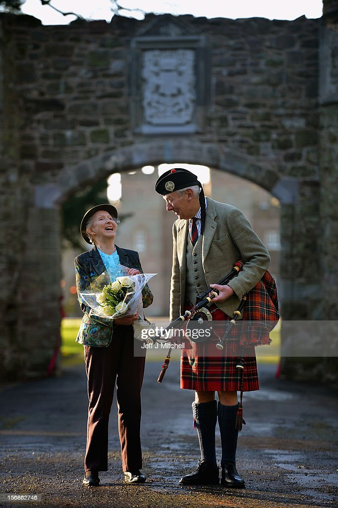 Pamela Countess of Mansfield and piper Malcolm Innes from Kilspindie help unveil the restored historic archway at Scone Palace on November 23, 2012 in Perth, Scotland. The iconic 16th century arch, which was all that remained of the approach to the Augustinian Abbey which once stood on the Palace lawns, was destroyed after a contractor driving a van crashed into it two years ago. Scone Palace is best known as the place where former kings of Scotland were crowned and the original home of the Stone of Destiny.