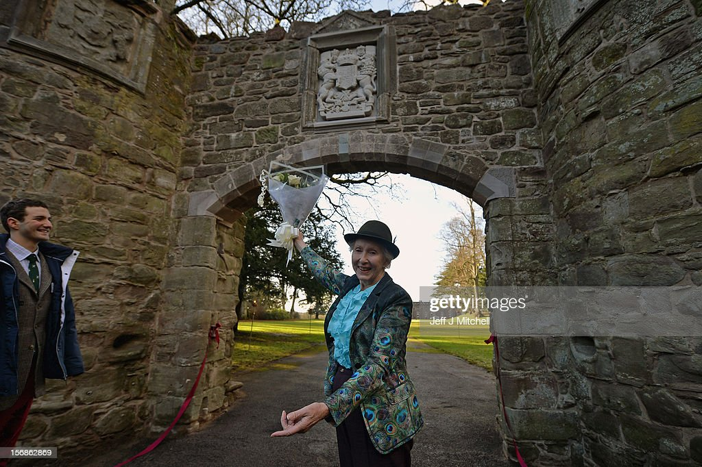 Pamela Countess of Mansfield and William Murray Master of Stormont help unveil the restored historic archway at Scone Palace on November 23, 2012 in Perth,Scotland. The iconic 16th century arch, which was all that remained of the approach to the Augustinian Abbey which once stood on the Palace lawns, was destroyed after a contractor driving a van crashed into it two years ago. Scone Palace is best known as the place where former kings of Scotland were crowned and the original home of the Stone of Destiny.