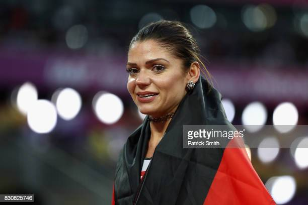 Pamela Dutkiewicz of Germany bronze celebrates with an German flag after the Women's 100 metres hurdles final during day nine of the 16th IAAF World...