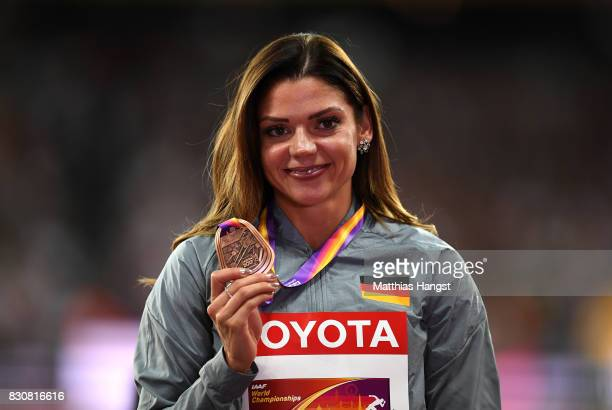 Pamela Dutkiewicz of Germany bronze poses with her medal for the Women's 100 metres hurdles during day nine of the 16th IAAF World Athletics...