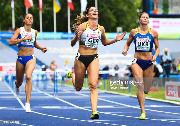 Pamela Dutkiewicz of Germany celebrates after winning in the Women's 100m Hurdles Final during day three of the European Athletics Team Championships...