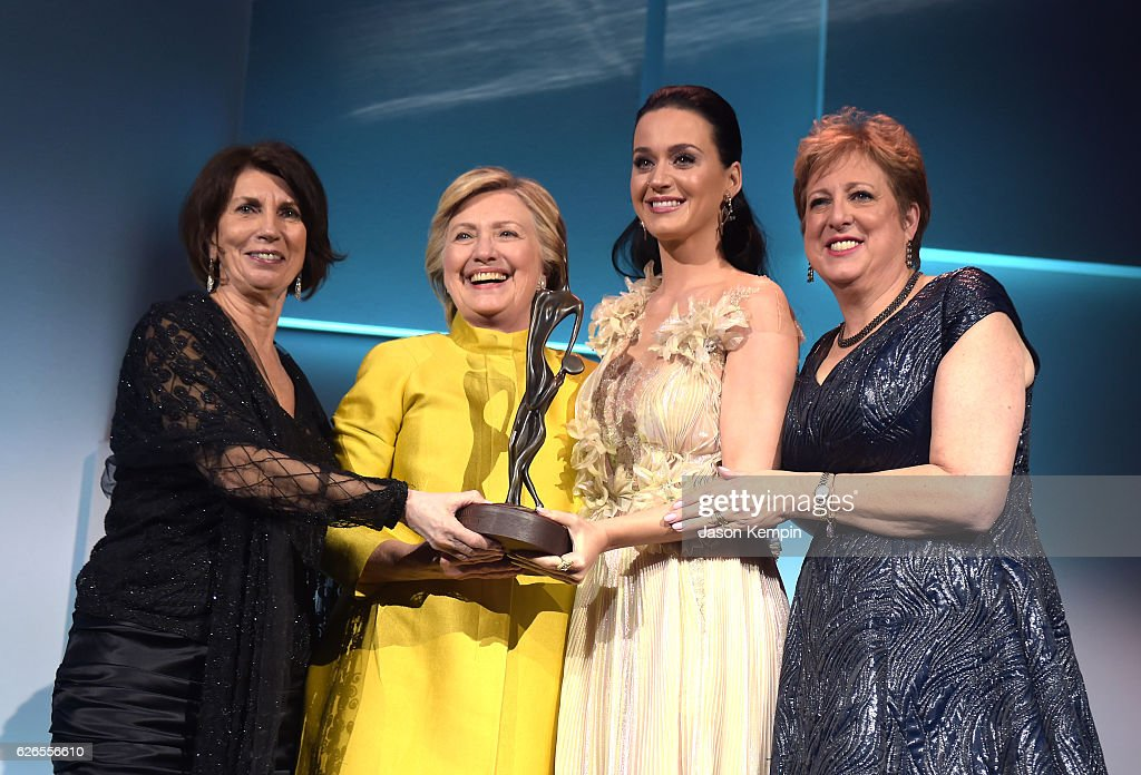 Pamela Fiori, Hillary Clinton, Katy Perry, and Caryl Stern speak on stage during the 12th annual UNICEF Snowflake Ball at Cipriani Wall Street on November 29, 2016 in New York City.