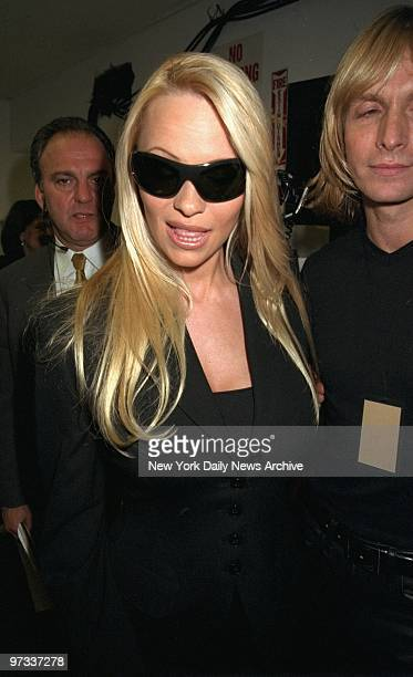 Pamela Lee Anderson backstage at the Marc Bouwer fashion show on W 40th St Bouwer will set out to remake Anderson's image with the clothes he will...