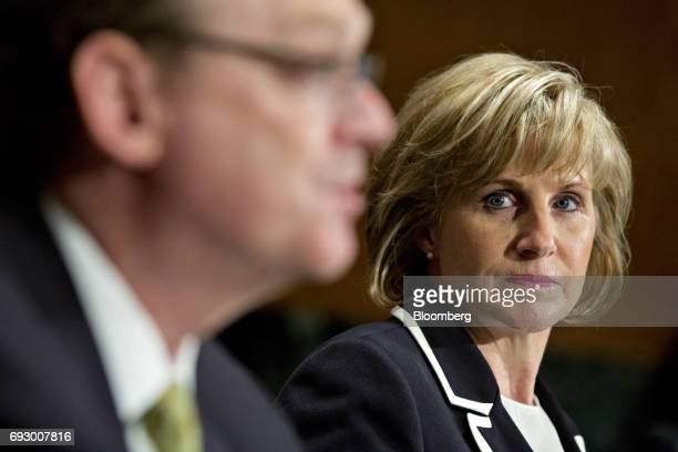 Pamela Patenaude deputy secretary of Housing and Urban Development nominee for US President Donald Trump right listens as Kevin Hassett chairman of...