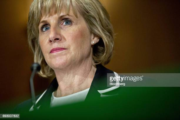 Pamela Patenaude deputy secretary of Housing and Urban Development nominee for US President Donald Trump listens during a Senate Banking Committee...