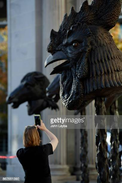 Pamela Scharf of Wheat Ridge takes a photo of the Zodiak sculptures at Civic Center Park The Denver Arts Venues celebrates the arrival of Ai Weiweis...