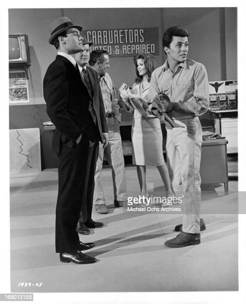 Pamela Tiffin and James Darren at an automotive shop in a scene from the film 'The Lively Set' 1964