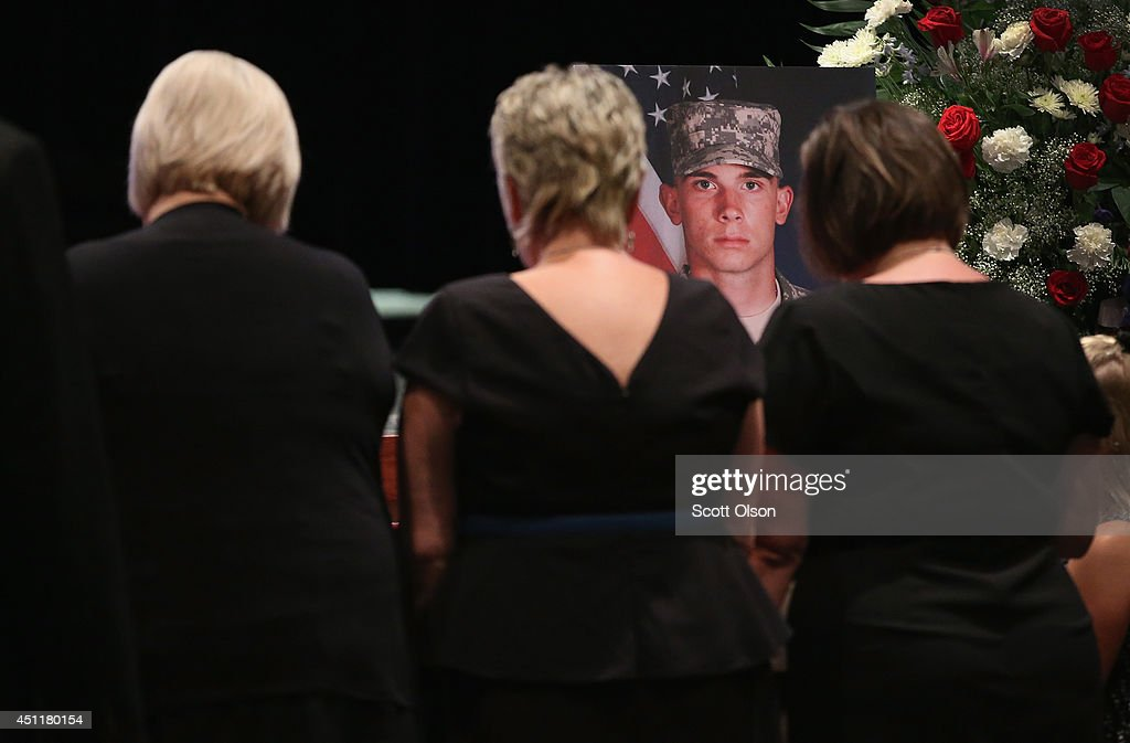 Pamela Toppen (C) and her daughters Amanda (L) and Amy view the remans of son and brother, U.S. Army Pfc. Aaron Toppen, during a funeral service at Parkview Christian Church on June 24, 2014 in Mokena, Illinois. Toppen, 19, was killed alongside four other American soldiers and an Afghan soldier in a friendly fire airstrike while they were engaged in a firefight earlier this month in Afghanistan.
