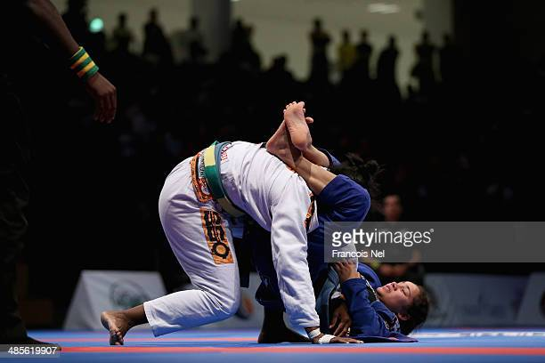 Pamela Ventura of Brazil competes with Amanda Nogueira of Brazil in the Women's blue belt open weight finals during the Abu Dhabi World Professional...