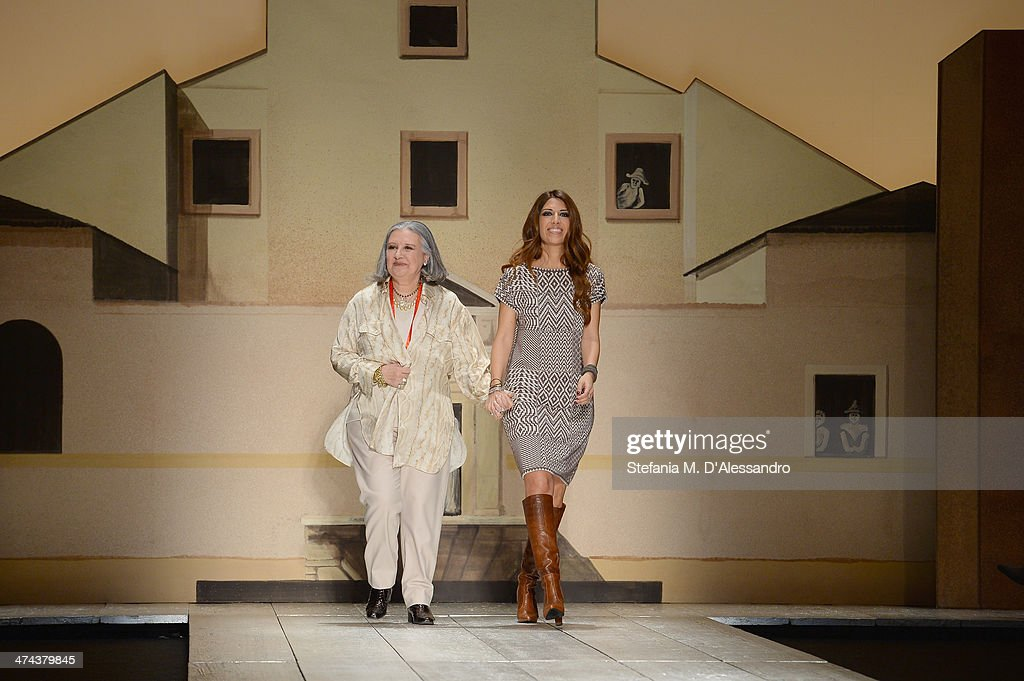 Pamela Villoresi and <a gi-track='captionPersonalityLinkClicked' href=/galleries/search?phrase=Laura+Biagiotti+-+Fashion+Designer&family=editorial&specificpeople=7024760 ng-click='$event.stopPropagation()'>Laura Biagiotti</a> walk the runway during the <a gi-track='captionPersonalityLinkClicked' href=/galleries/search?phrase=Laura+Biagiotti+-+Fashion+Designer&family=editorial&specificpeople=7024760 ng-click='$event.stopPropagation()'>Laura Biagiotti</a> show as part of Milan Fashion Week Womenswear Autumn/Winter 2014 on February 23, 2014 in Milan, Italy.