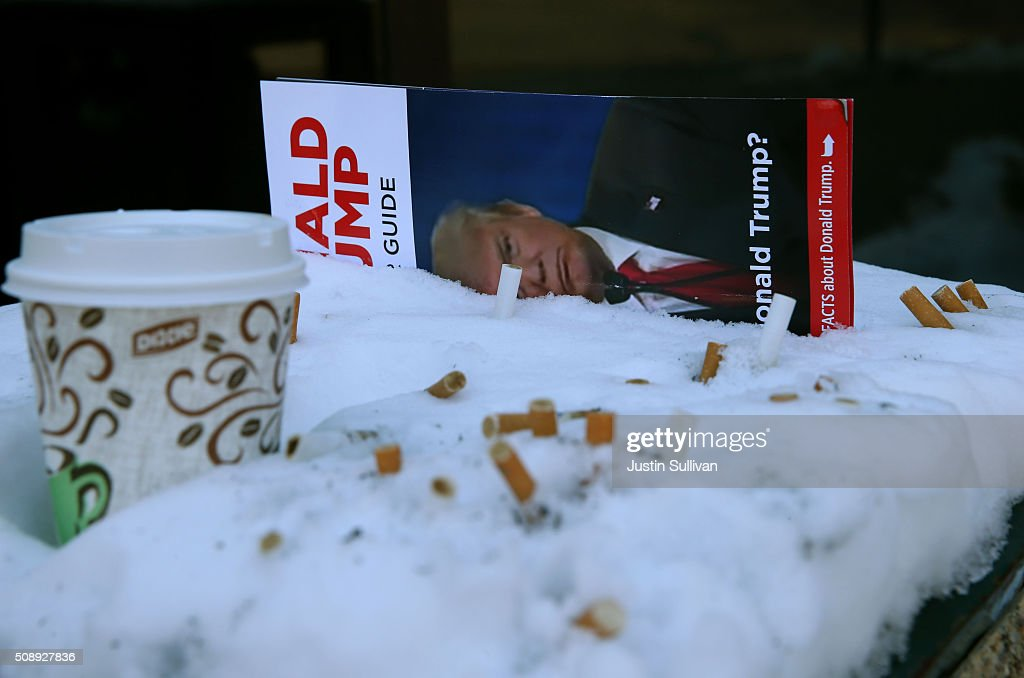 A pamphlet with an image of Republican presidential candidate Donald Trump sits in a snow-covered ashtray on February 7, 2016 in Manchester, New Hampshire. ith less than one week to go before the New Hampshire primaries, candidates continues to campaign throughout the state. (Photo by Justin Sullivan/Getty Images