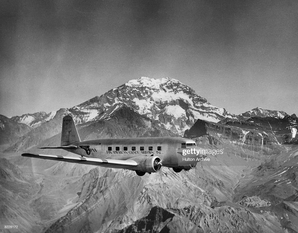 A Pan American Grace Airways passenger plane flies past Mt Aconcaqua at 23, 089 feet above sea level during a flight from Chile to Argentina.
