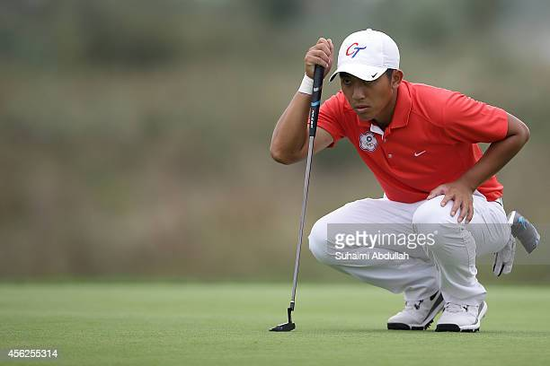 Pan Cheng Tsung of Chinese Taipei in action in the golf menÕs individual and team event round 4 on day nine of the 2014 Asian Games at Dream Park...
